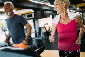 senior couple exercising on treadmill